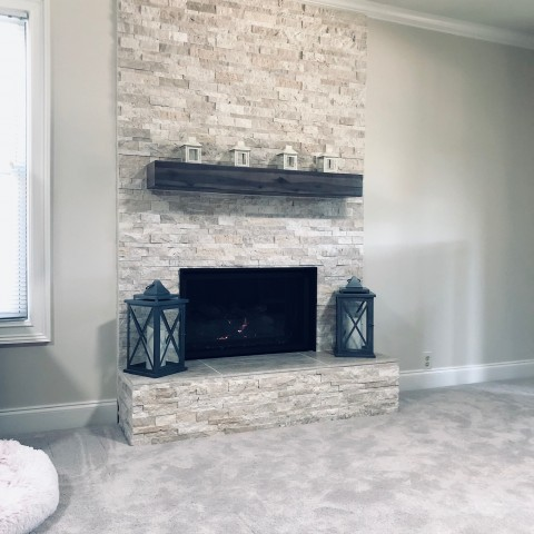 white slate fireplace with wood beam mantel