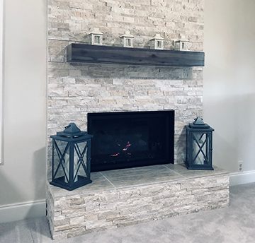 white slate fireplace wood beam mantel